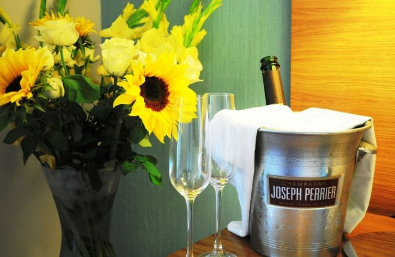 Celebrate with a bottle of champagne & flowers